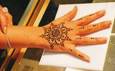 henna tattoo design on hand