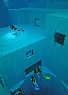 Nemo 33 in Belgium is the world's deepest pool. It is 33 meters deep and consists of a submerged structure with flat platforms at various depth levels.