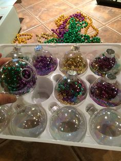 Mardi Gras Tree ornaments! Turn regular glass Christmas ball ornaments to Mardi Gras with beads!