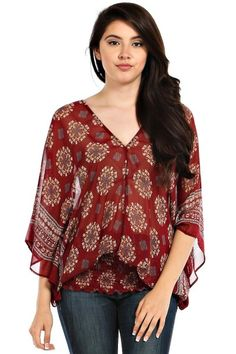 This  medallion pattern tunic in burgandy is everything trending for 2015. The v-neck flatters your neckline and the elastic gathered bottom accentuate those hips, but yet its still flowing and free. Perfect to layer with a crochet or fur vest to create that look right off of vouge. Be the trend setter in this hot top! http://laneylus.com/product/boho-babe-burgandy/