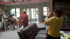 Dr. Cristina Gilstrap photographing Brian Shipman's class in Shewmaker lobby - Fall 2012