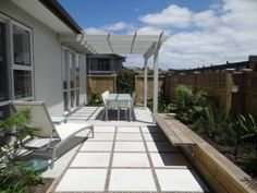 Tiny but sunny courtyard for brand new townhouse. Pergola, raised garden bed, bench seat.