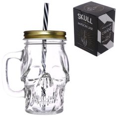 Skull Shaped Glass Drinking Jar with Straw  Made from glass and with a metal lid and plastic straw  Dimensions: Height 13cm Width 11cm Depth 8.5cm Straw Length 17cm Diameter 0.5cm  Delivery prices available on checkout