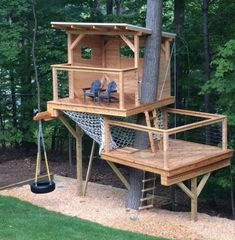 Playhouse with hammock net Tree house with hammock net Two level tree house Two . Playhouse with hammock net Tree house with hammock net Two level tree house Two level playhouse Backyard Playground, Backyard For Kids, Nice Backyard, Fenced In Backyard Ideas, Backyard Zipline, Tree House Playground, Kids Zipline, Cubby Houses, Play Houses