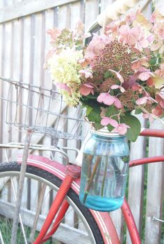 all bikes would come in the colors of pink, lavender, sky blue, or spring green and all of them would have handy flower-carrying devices