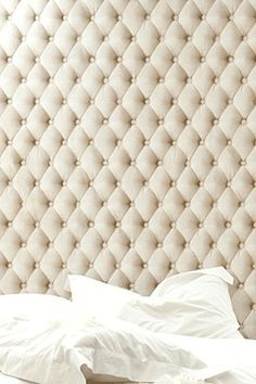 Really high quilted headboards are great.