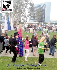 Our stilt walker joins the Electric Slide with Vernon the Mime. Entertainment by San Diego SPotlight Entertainment.