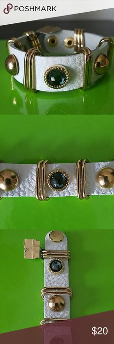 FLASH SALE Beautiful White Leather Bracelet White leather bracelet with gold hardwear and gray blue stones. Snap closure adjustable 7 to 8 inches. Has what appears to be a Brighton tag but it doesn't say Brighton anywhere on the bracelet so it may or may not be. Either way, this is a beautiful and well made bracelet. Give your summer whites an extra pop. Jewelry Bracelets