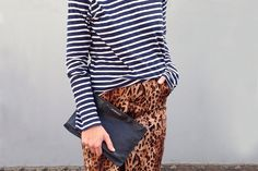 The easiest way to feel sophisticated in leopard is with a feminine silhouette. This pencil skirt is the perfect option. Pair it with a crisp white blouse, black sweater, or chambray shirt to downplay the print. If you want to be bold, add a stripe or floral pattern and statement jewelry.