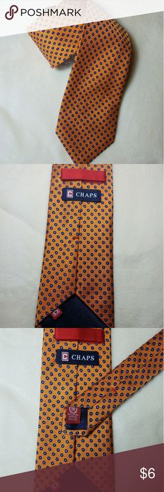 Chaps 100% Silk Orange navy blue polka dot tie Men's Chaps necktie. Orange with navy blue polka dots. 100% silk handmade. Great pre owned condition. Smoke free home. All sales final. Chaps Accessories Ties