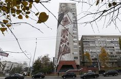 Beautiful Ukrainian girl mural: Kyiv's street art revolution builds - http://streetiam.com/beautiful-ukrainian-girl-mural-kyivs-street-art-revolution-builds/