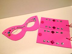 DIY- superhero masks and cuffs. Supply the jewels and have the girls decorate themselves.