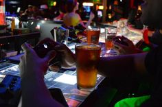 "Player 1 offers a unique gaming themed experience. Here you'll find console games, a rotating selection of cabinet games, PC gaming and board games. They have an extensive beer list, both draft and bottled, as well as game inspired cocktails like the ""Nuka Cola"" and the ""Phoenix Down"". And it will all be served to you by wait staff dressed in game character costumes!"
