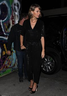 Statuesque stunner: Taylor Swift cut an incredibly stylish figure in her funky jumpsuit which she pulled off to perfection