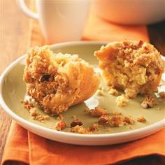 Apple Crisp Muffins Recipe -Waking up to the smell of apple muffins will start your family's day off right. Cream cheese filling makes them moist and tender, and oats and nuts in the topping add crunch.—Connie Boll, Chilton, Wisconsin