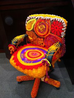 "Chair belonging to Mary Hughes Hynes, Chair of the Arlington County Board, was yarn bombed by the Artisphere Yarn Bomb's Guerrilla Stitch Brigade -- a successful ""first strike."""