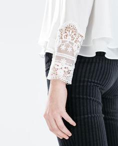 Image 5 of TOP WITH EMBROIDERED CUFF from Zara