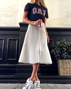 French Street Style: Black Gap Tee; White, Pleated, Metallic A-line Skirt; and White Adidas Sneakers [ Les Brèves - Tendances de Mode ]