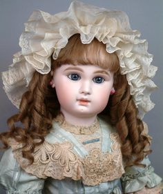 With a tender expression and a pale complexion this sweet little miss is imbued with that rare quintessential quality that distinguishes a pure bred