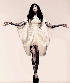 THAT DRESS. THAT INK. Just wow!