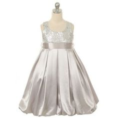 A beautiful Christmas dress for your toddler or little girl by Kids Dream. This dress has a sequined bodice with square neckline. This has a shiny sating bubble hemmed and finished skirt. The perfect dress for this Christmas or other special occasion.