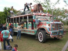 """A local transportation in Colombia- icon of the contry- painted """"buses""""  Note design not advertisement! (Ali)"""