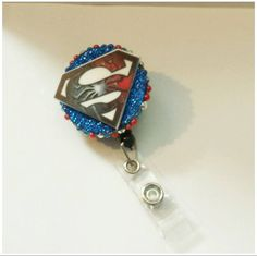 Check out this item in my Etsy shop https://www.etsy.com/listing/170202363/badge-reel-superman