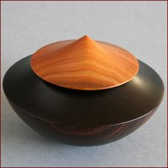 Turned Wood - Jacob Weissflog. Box with spinning top, 2013. African Blackwood, Putumuju. [Click for a high-end gallery of various works]