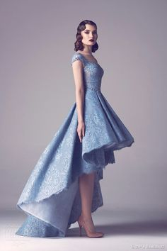 Powder Blue Lace High Low Ball Gown Featuring Illusion Boat Neckline & Capped Sleeves With Pleated Lace Skirt; by Fadwa Baalbaki Couture Spring 2015·····