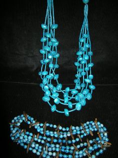 Vintage Simulated Turquoise Necklaces from Hawaii  Items are in very good condition Included:   5 Layer Bold Chunky Turquoise Wood Beaded