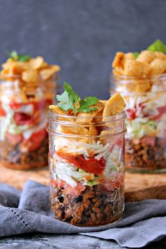Mini FRITOS Taco Salads from http://cravingsofalunatic.com- These Mini FRITOS Taco Salads are the perfect dish to whip up for potlucks or picnics. They are incredibly easy to make and can customize them to your own taste. (/CravingsLunatic/)