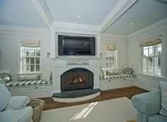fieplace with window seats | window seats beside fireplace | Basement