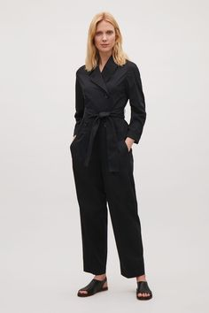 Trench meets jumpsuit. Belted trench jumpsuit in Black from COS.