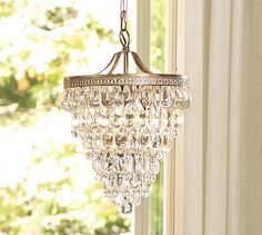 Clarissa Glass Drop Chandelier: Hundreds of glass droplets form a shimmering cascade on this chandelier. Crystals in alternating teardrop & raindrop shapes, with a faceted globe at the bottom, are so densely strung they completely cover the metal framework. #potterybarn