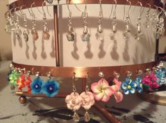Swarovski plum beads on sterling silver pinch bails and dangle earrings and polymer flowers centered with clear gems on dangle earrings as well
