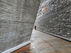 Amateur Architecture Studio's 2008Ningbo Historic Museum features a bamboo-formed concrete wall (left) as well as wapan masonry construction (right).