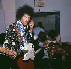 American guitarist Jimi Hendrix (1942 - 1970) of The Jimi Hendrix Experience, in a London recording studio, October 1967. In the background (right) is bassist Noel Redding (1945 - 2003).