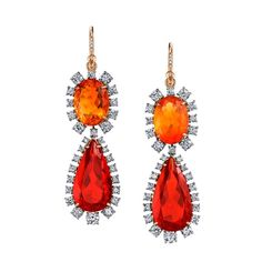 Irene Neuwirth is one of the world's largest collectors of opals, so it's no surprise to see these Mexican fire opals at the heart of her one-of-a-kind earrings, surrounded by white diamonds. Discover more jewellery: http://www.thejewelleryeditor.com/shop/product/irene-neuwirth-fire-opal-earrings/ #jewelry