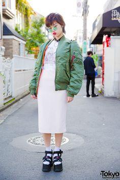 bomber jacket, 90's platform shoes, flatforms, pencil skirt, green round sunglasses.