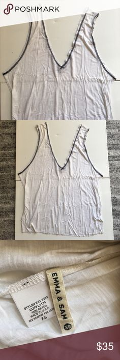 Emma & Sam Deep V Tank Emma & Sam Deep V Tank. Oversized fit. Black contrast stitching. Size XS. Tiny tiny hole by back deep v (VERY unnoticeable). Only worn a few times. No trades. LF Tops Tank Tops