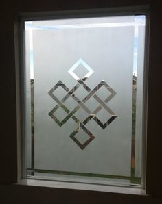 How To Frost A Window For Privacy - Frosted Window DIY :: spray paint and frog tape - create your own design. nice!