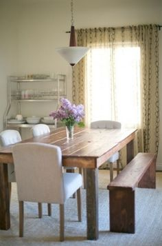 Try a dining room table made of reclaimed wood for a sleek, rustic look. (image via cupcakesandcashmere.com)