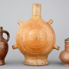 A lot of 3 saltglazed stoneware jugs incl. a Raeren pilgrim's flask or gourd, 17th and 19th C.