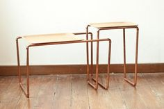 DIY Decor Trend: Copper  Palmbomen made these side tables out of copper tubes and wooden trays.