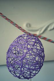 close up of a purple, meshy and hollow egg-shaped ornament, easter arts and crafts, hanging on multicolored woven rope Simple Christmas, Christmas Bulbs, Easy Christmas Candy Recipes, Easter Arts And Crafts, Egg Decorating, Easter Party, Easter Wreaths, Paper Flowers, Easter Eggs