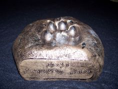 Guide Dogs paw print in resin-metal bronze