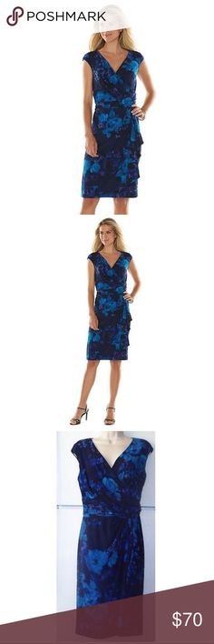 "CHAPS BLUE FLORAL CROSSOVER SURPLICE DRESS You'll attract attention in this women's blue floral Chaps dress!. A crossover-waist design and draped, faux-wrap skirt give you a flattering, stylish silhouette.  PRODUCT FEATURES Floral print Surplice neckline Sleeveless Stretchy jersey construction Unlined FIT & SIZING 40 1/2-in. approximate length from shoulder to hem Chest (S 34""), (M 36""), (L 40""), (XL 42"") Polyester, elastane Machine wash Chaps Dresses Midi"