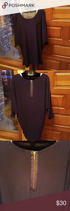 Joseph Ribkoff Blouse Great used condition. Navy Blue. Very flattering and slimming as the blouse tapers down toward the bottom. It rests on your hips. It drapes beautifully on any body type.  The zipper detail on the back makes this blouse unique. Joseph Ribkoff Tops Blouses