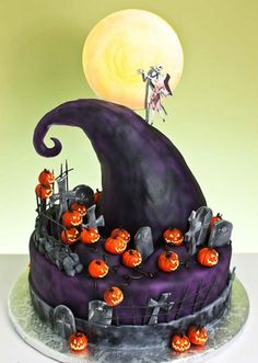 Jack and Sally Cake  This cakes shading is so perfect. The black and purple just really makes the cake pop with the little orange pumpkins!