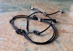 Black Leather Infinity Bracelets, Couples Infinity Bracelets, Pair of Leather Infinity Bracelets, His & Her Infinity Bracelets,Birthday Gift by SpryHandcrafted on Etsy Infinity Bracelets, Handmade Beads, Handmade Gifts, Rose Quartz, Earring Set, Personalized Gifts, Birthday Gifts, Copper, Black Leather
